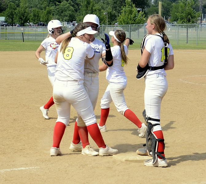 The Colorado Classics celebrate their 4-3 win over Pride-Watts in an elimination game Saturday at the USSSA Mountain States Championships at the Barnes complex. (Mike Brohard/Loveland Reporter-Herald)