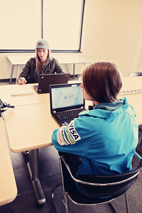 Madison Olsen (Freestyle Aerials), front, and Alex Micinski (Freeskiing), back. Students attending the USSA Team Academy in the Center of Excellence studying with the help of their IBM computers. Photo: Sarah Brunson/USSA