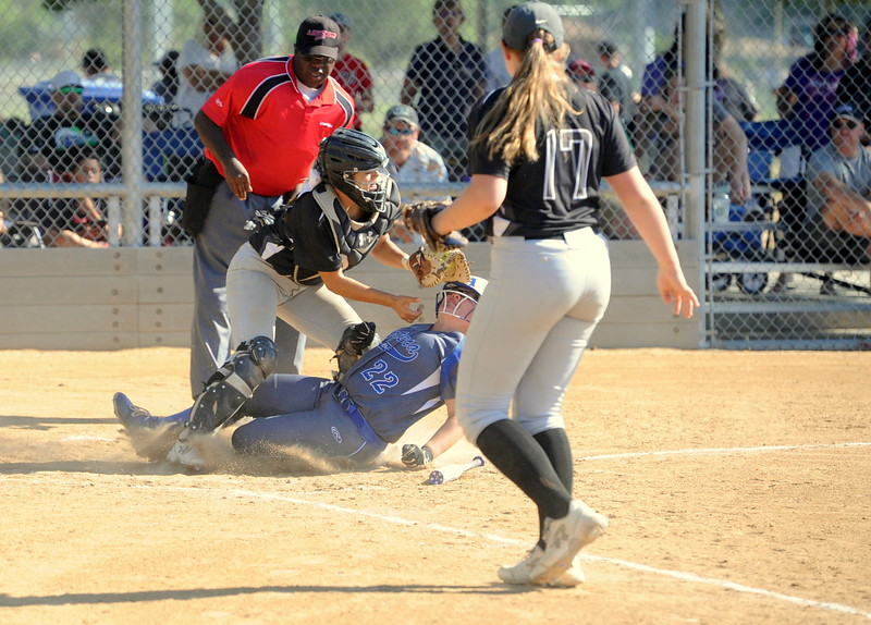 Rocky Mountain Rush catcher Kylea Wall tries to make a tag as teammate Bailey Bohlender looks on during the USSSA 16U B Mountain States Championship tournament at Barnes Complex in Loveland.