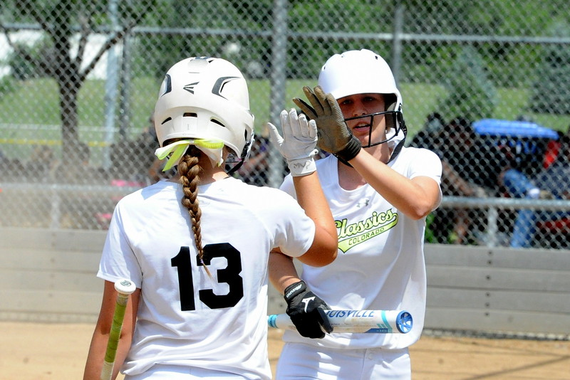 Colorado Classics teammates Lee-Ann Kuckuk and Ryley Long high five during the USSSA 16U B Mountain States Championship tournament at Barnes Complex in Loveland.