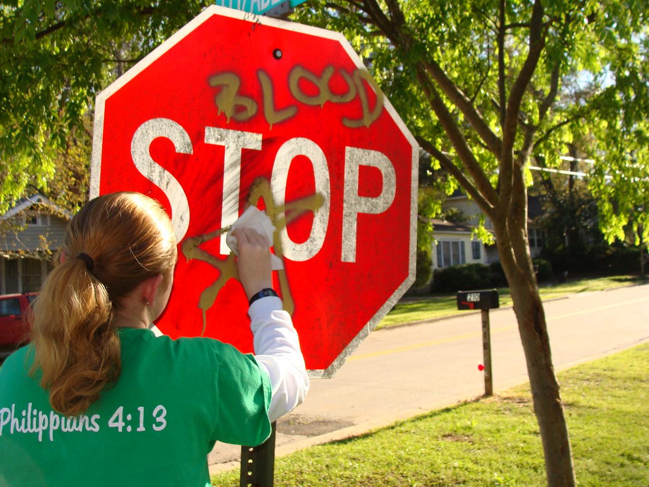 09 03-28 Removing gang markings near Chuck Davis lot. klb