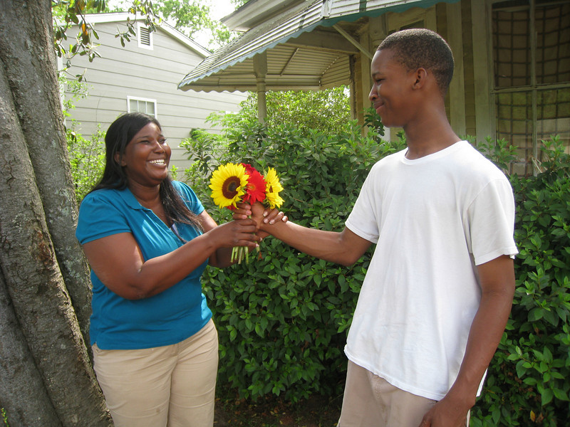 09 -05-03 Eldest son Tyner presents flowers to his mother for Mothers Day. ff