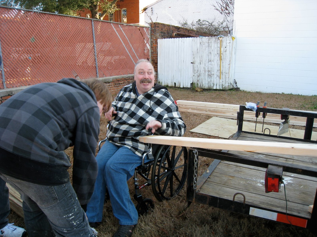 10 1-17 MLK Day - Chuck Davis gives a hand to holding boards for the table saw.  ky