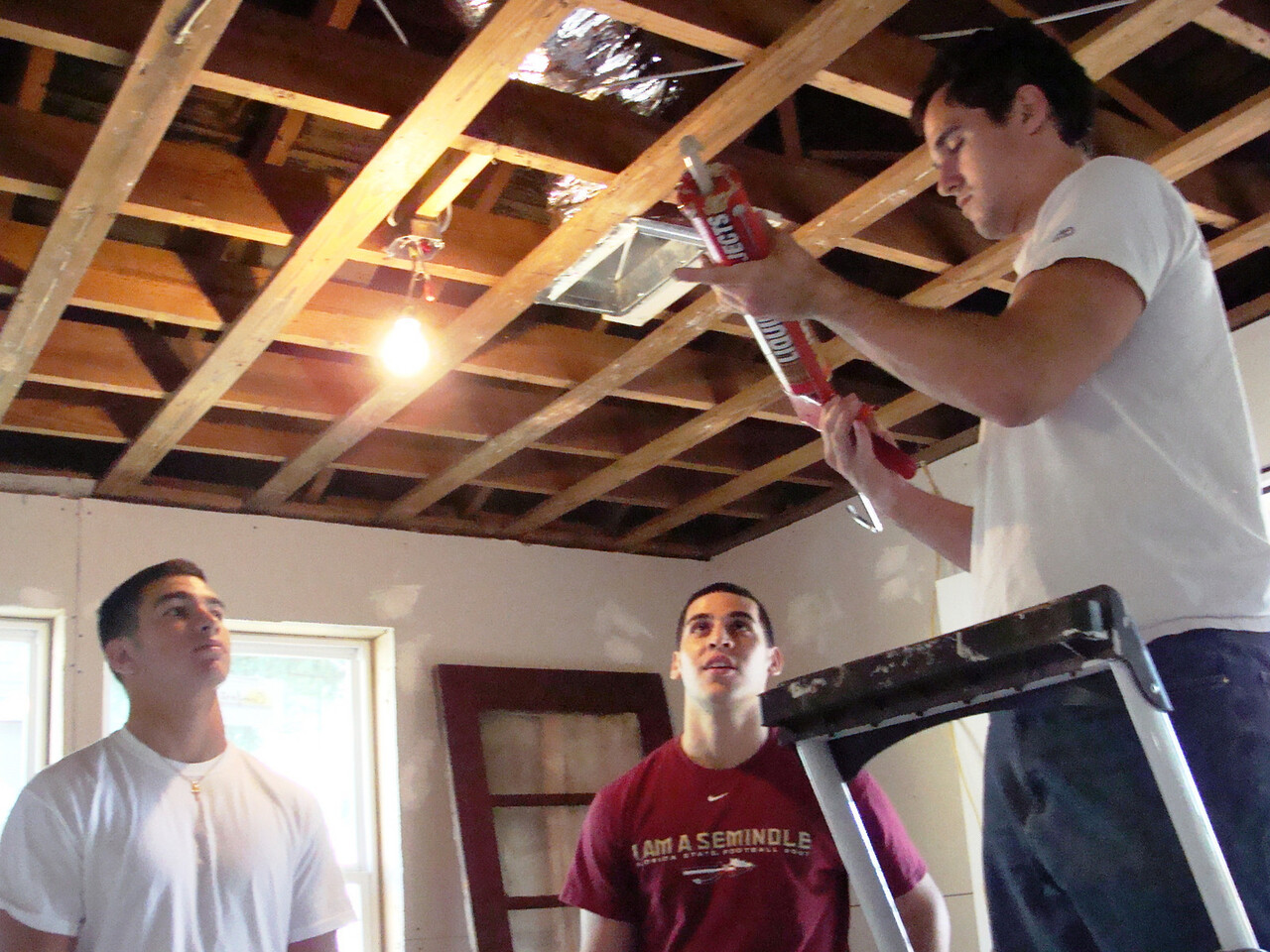 08 11/08 - FSU student applying glue prior to putting up dry wall. kl-b
