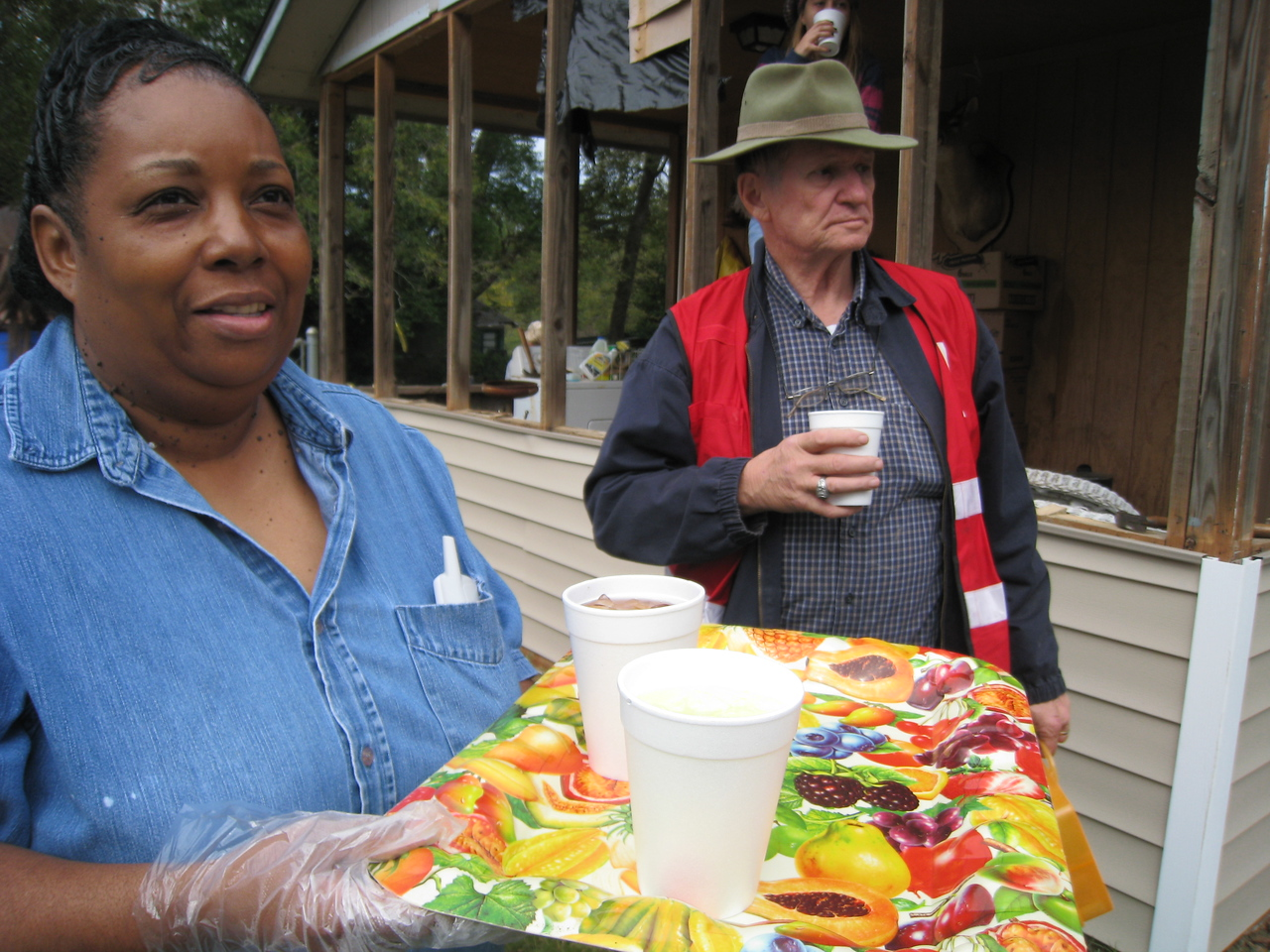 09 10-24 Anita Lyles brings cold drinks to the volunteers working on her home. ky
