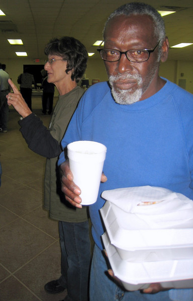 09 11-14  E.T., grounds-keeper for Fuller Center gets some take-outs. Behind him, Cathy Smith visits with people in line waitng to be served at Fish Fry & Auction Fundraiser.  lcf