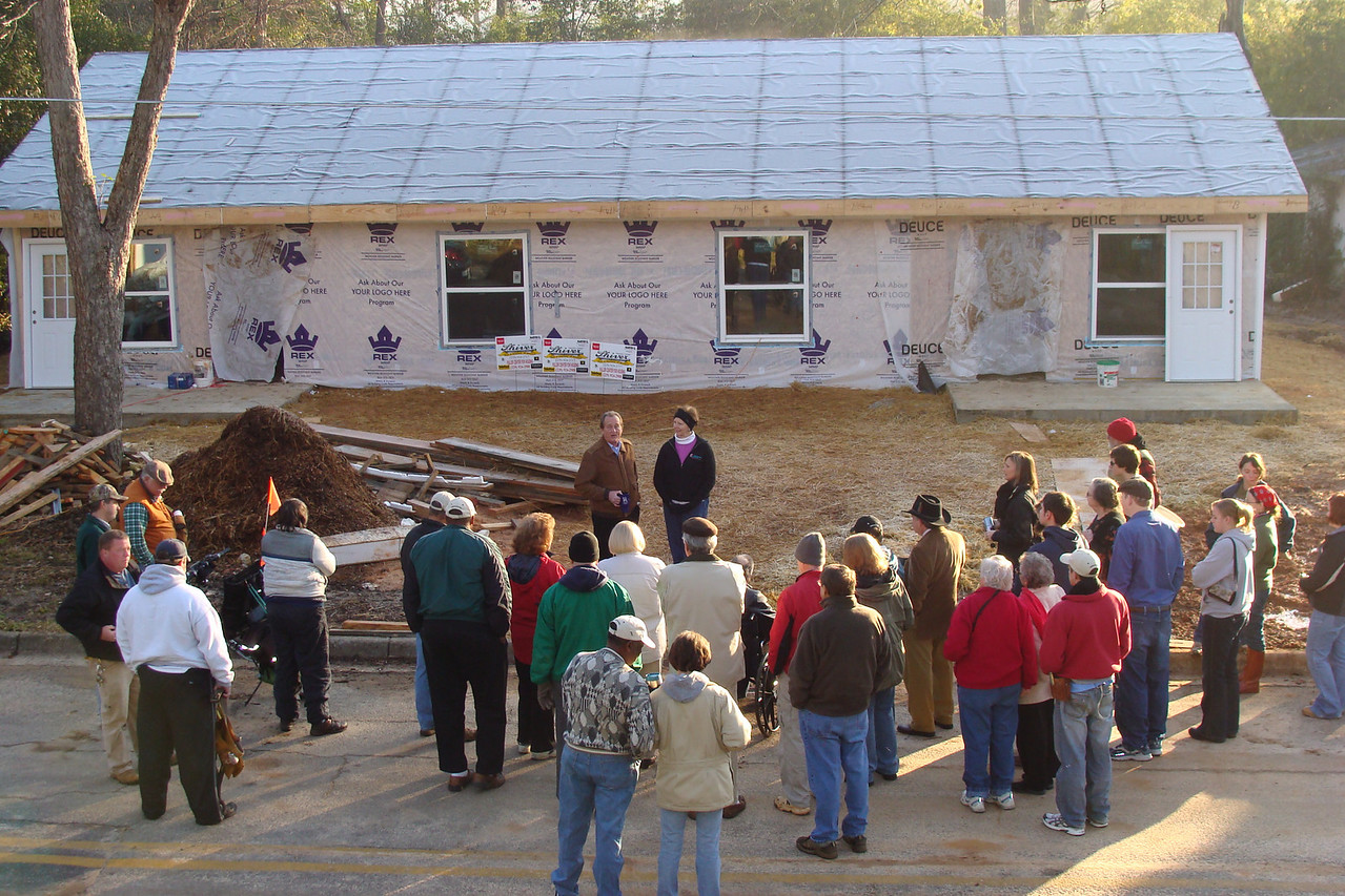 10 02-03  David Snell circles Fuller Center staff and other Americus folks for devotions before house work begins. ff