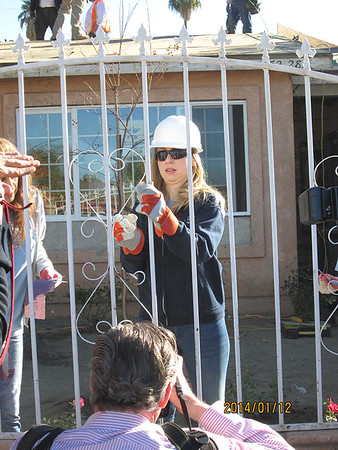Chelsea Clinton works on a Desert Communities Fuller Center home in the Coachella Valley.