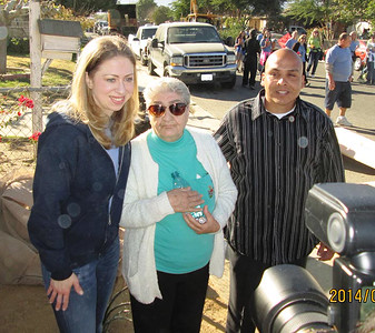 Chelsea Clinton visits with a Desert Communities Fuller Center homeowner partner in the Coachella Valley.