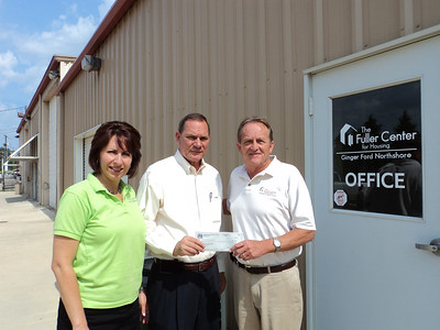 David and Tamara Danel, volunteers with Ginger Ford Northshore Fuller Center in Hammond, LA present a tithe check to David Snell, president of Fuller Center for Housing.  In addition to the tithe, Ginger Ford Northshore Fuller Center is committing $500 toward the Legacy Build in Peru.