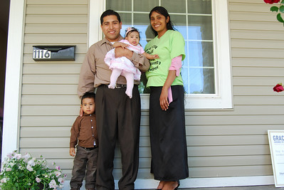 10 05-14 The Martinez family standing on the front porch of their new home. CL