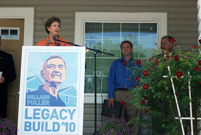 10 05-14  Linda Fuller shares what this beautiful home and family means to her as the first work completed at the site of Millard Fuller Legacy Build to be held in September.  Mark Stewart, president of SEND (Southeast Neighborhood Development) is standing to Linda's left. CL