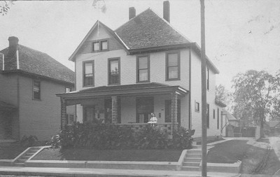 Scott Simpson shared this century-old photo of his grandmother sitting on the porch of 1116 St. Paul Street in Indianapolis.