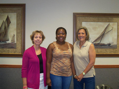 Traci Crosby, homeowner partner Tiffany Core and Kim Roberts