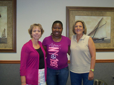 Traci Crosby, homeowner partner Reshyra Walker and Kim Roberts.