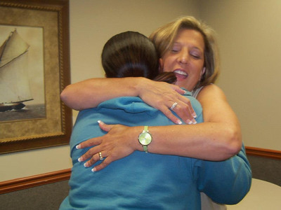 Kim Roberts, right, congratulates homeowner partner Reshyra Walker.