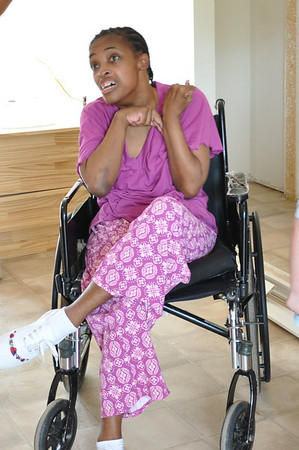 2010 07-16 Mattie, daughter of Jennifer Magby. She's so happy about their new home that has wheelchair accessibility.  Photos by  Bobbie McBone