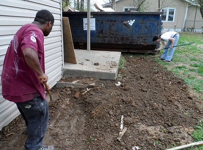Youth Build volunteers work outside the home of Connie Cash.