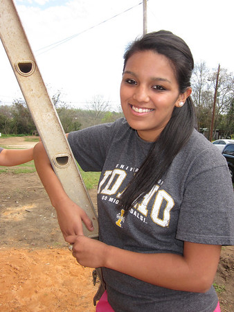 University of Idaho student Yvette Yzaguirre work on the Southwest Quarter Fuller Center home in Lumpkin, Ga., on March 14, 2012.