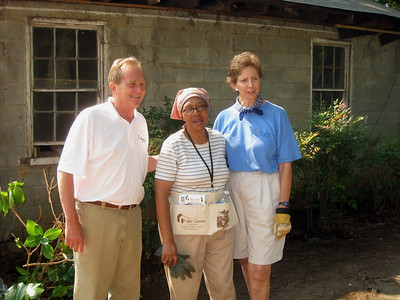 David Snell and Linda Fuller pose for a photo op with Lillie Miller.  ky