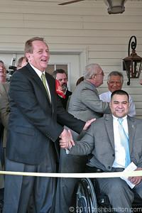 2011 04-02 David Snell, president of the Fuller Center for Housing congratulates Josh Himan. Trish Hamilton