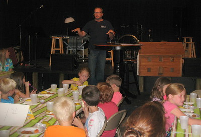 Fuller Center Director of Communications explains the Christian housing ministry's work around the world and in Perry to Crossroads UMC's Vacation Bible School students.