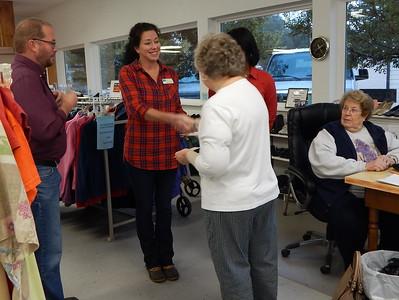 Samaritan Closet Director Judith Lilley presents a $1,000 donation to Jennifer Bell of Path to Shine.