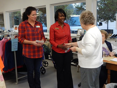 Samaritan Closet Director Judith Lilley presents a $1,000 donation to Nicole Rosser of Family Promise of Greater Houston County.