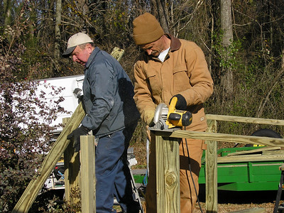 o7 11 Captain Urch of Spartanburg Sheriff's Department and his father Albert Urch work to build a wheelchair ramp for Ms. Linda Bivens. Sharon McFalls