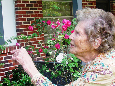 Ms. Mallory showing off her roses. bb