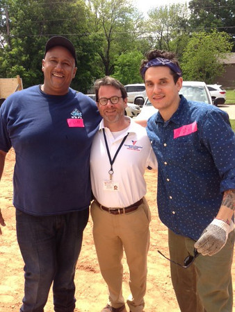 Veteran Cliff Malone (left) and Volunteers of America rep Brian Byrd with Grammy-winner John Mayer (right)