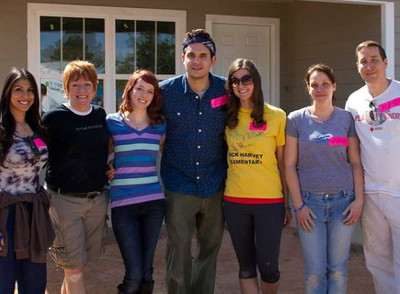 John Mayer poses with fans who won a contest allowing them to volunteer with him on a Fuller Center project, the 2013 Veterans Build.