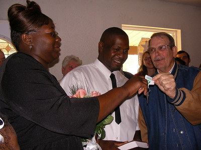 09 03-28 Charlie Park of Webster Parish, LA Fuller Center presents house keys to Christine and Johnny Walker.