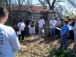 08 Webster Parish, LA - Volunteers from St. John's Episcopal Church in Minden listen while homeowner Billy Joiner (5th from left) tells them about himself.