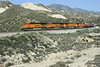 BNSF 7777, 7774, 7725 & 7735, Mormon Rocks, Cajon Pass, California, Mon 29 April 2013 1 - 0902.  Here are three shots of this train descending the pass on Main 2.  All four locos are GE ES44DCs.