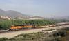 BNSF 7776 & 4412, Cajon, California, Tues 30 April 2013 - 0824.  An empty stack train heads down Main 2 behind the GE ES44DC & Dash 9-44CW...