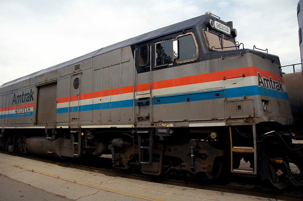 San Luis Obispo, California, Sat 30 September 2006 7 - 1625.  Amtrak 90208 is a non-powered control unit converted from an EMD F40PH loco.  The unit still has driving controls, and the roller door allows baggage to be carried in the former engine compartment.