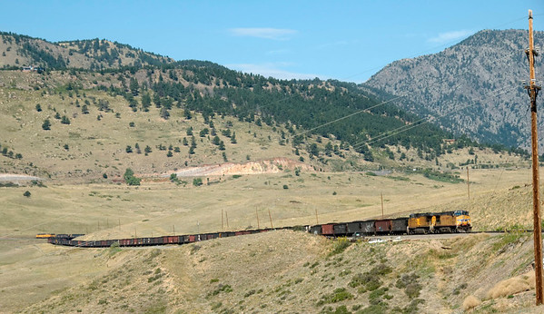 Rocky, Colorado, 31 August 2008 1 - 1017     UP C44AC-CTE 5759 & C44AC 6368 on an eastbound coal train wait to meet a westbound BNSF manifest.  A third, unidentified, loco can be seen on the rear.  Rocky is 18 miles west of Denver.  The Moffat line can just be seen climbing from left to right above the train towards Coal Creek Canyon at right.