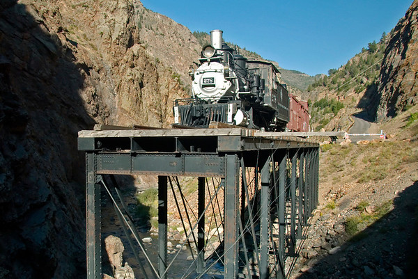 Denver & Rio Grande Western No 278, west of Cimarron, Colorado, 8 September 2008 1.  No 278 stands in the Black Canyon of the Gunnison River on an isolated remnant of DRGW's original three foot gauge main line from Denver through the Royal Gorge, over Marshall Pass and through Gunnison and Cimarron to Utah and the west.  The line opened in 1883, was 771 miles long over gradients as steep as 4%.  It took 41.5 hours to traverse.  The DRGW's main line soon became its standard gauge route over Tennessee Pass in northern Colorado.  The Marshall Pass line was never converted to standard gauge, but carried local traffic until closure in the early 1950s.  Damwater has since flooded some of the DRGW route; this bridge is near Morrow Point dam.