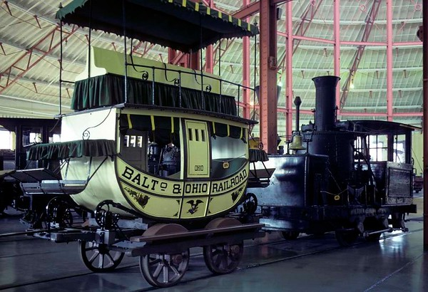 Replica Baltimore & Ohio RR coach and No 8 John Hancock, Baltimore & Ohio Railroad Museum, Baltimore, Maryland, August 1979.  The 'Grasshopper' 0-4-0 was built in 1836 by the B & O.  Photo by Les Tindall.