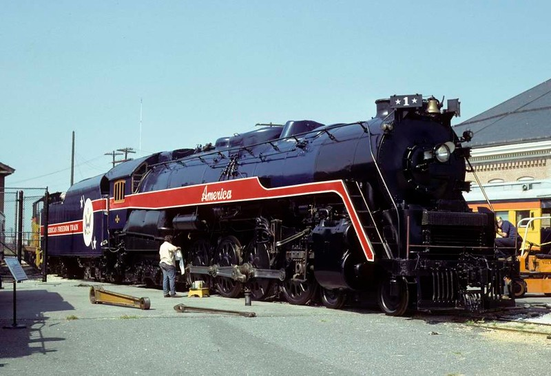 American Freedom Train No 1 (Reading Railroad No 2101), Baltimore & Ohio Railroad Museum, Baltimore, Maryland, August 1979. Built in 1923 by Baldwin as a 2-8-0, rebuilt by the Reading in 1945 as a 4-8-4.  The American Freedom Train celebrated the US Bicentennial in 1976 and was hauled by No 2101.   In March 1979 No 2101 was damaged by fire in Kentucky and is seen at the B & O Museum after cosmetic repairs.  Photo by Les Tindall.