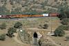 BNSF 6955, 7020 & 1087, Tehachapi loop, California, Wed 1 May 2013 2 - 0855.   ...the BNSF locos (two GE ES44C4s and a C44-9W) cross Tunnel 9 as they run alongside the UP...