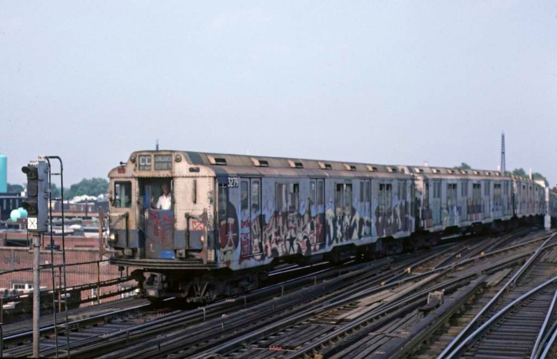 A New York City Subway train led by 3279 comes off the Rockaway line at Rockaway Boulevard, Queens, on 10 July 1078.  The heavily graffitied R10 stock had been built by American Car & Foundry 1948-49.  (Photo by Les Tindall.)