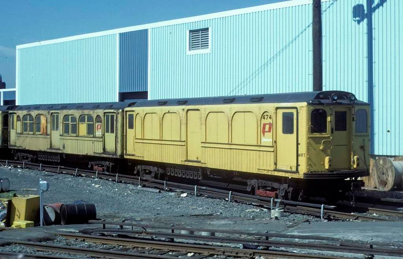 Port Authority Trans-Hudson (PATH) maintenance of way stock, Jersey City, 10 July 1978.  The old coaches are 474 and 517.  (Photo by Les Tindall.)