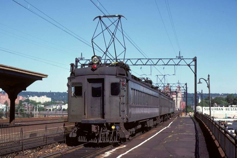 An Erie-Lackawanna four car EMU from Hobolen NJ passes Brick Church station, East Orange NJ, on 10 July 1978.  (Photo by Les Tindall.)