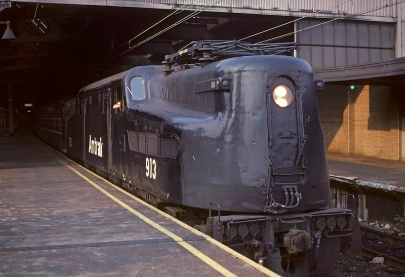Amtrak GG1 913, Newark NJ, 10 July 1978.  139 of these iconic electric locos were built for the Pennsylvania RR 1939-43.  After Penn Central went bakrupt in 1979 Amtrak bought 30 and used them until 1980 when they were replaced by AEM7s.  (Photo by Les Tindall.)