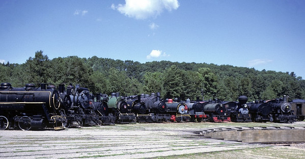 Welcome to Steamtown, Bellows Falls, Vermont! 12 mainly industrial locos stand around the turntable on 25 July 1978.  Photo by Les Tindall.