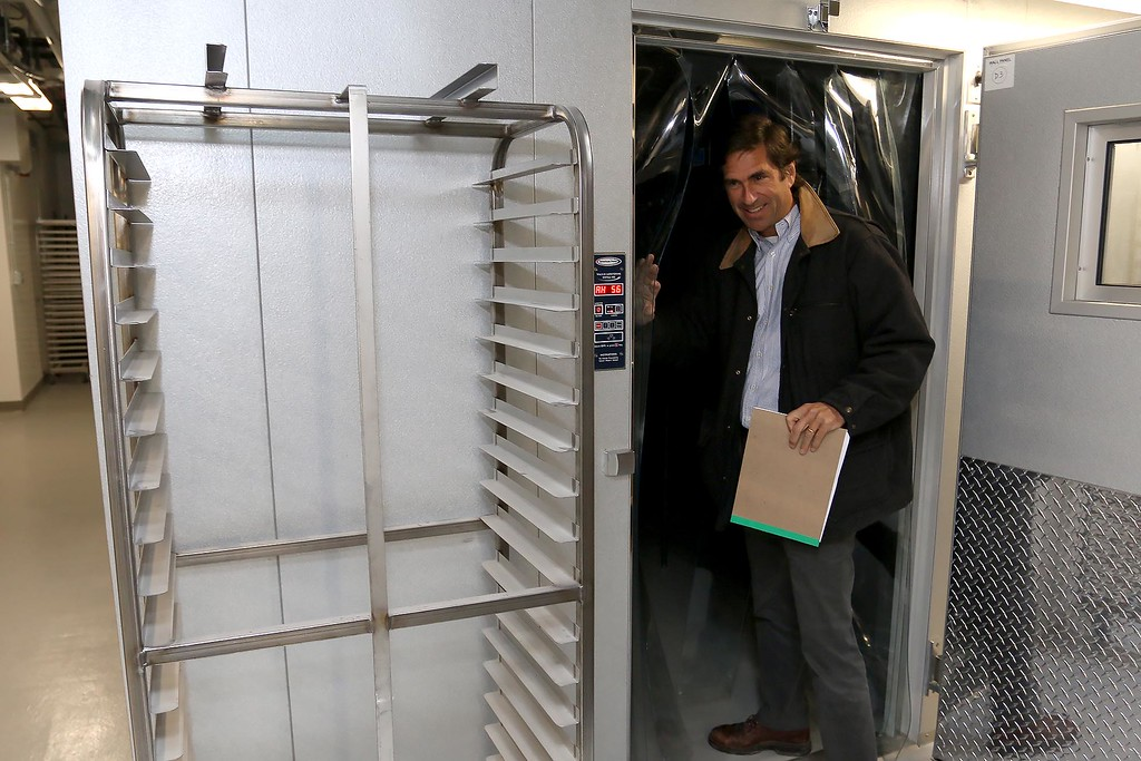 . Ed Frechette the Chief innovation officer at UTEC shows off their fridge and freezer in their new 5,000 square foot commercial-grade community kitchen in Lowell. SUN/JOHN LOVE