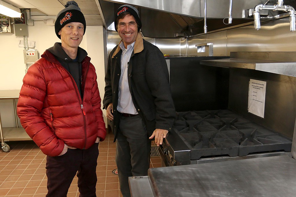 . Ed Frechette the Chief innovation officer at UTEC, on right, and Sam Putnam the culinary innovator stand near the stove in their new 5,000 square foot commercial-grade community kitchen in Lowell. SUN/JOHN LOVE