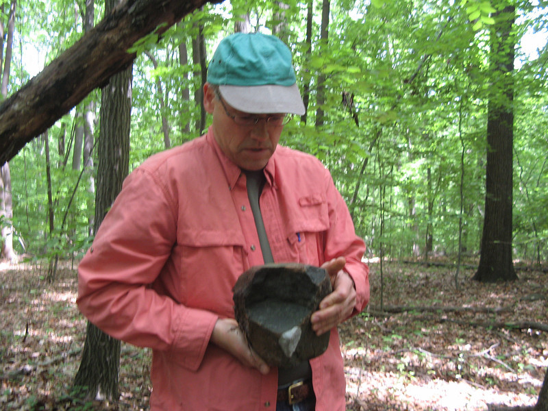 Ned displaying a piece of granite with a feldspar inclusion (the white patch in front)